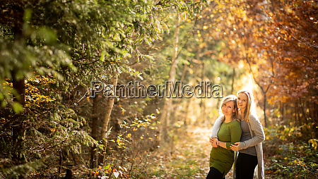 mother and daughter in beautifiul autumn