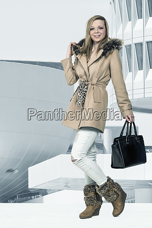 young woman with trendy autumn clothing