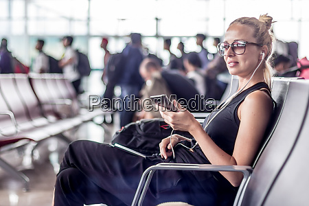 female traveler talking on cell phone