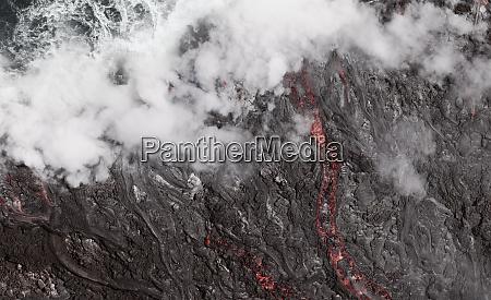 lava flow into the ocean hawaii