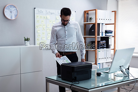 businessman using printer in office