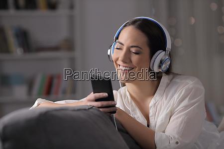 happy woman listening to music feeling