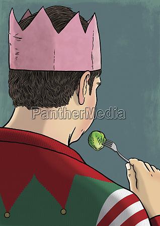 man eating sprouts at christmas