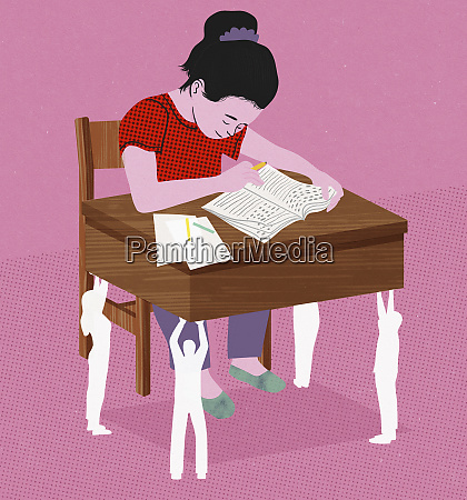 young girl working at school desk