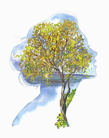 autumn tree inside of womans head