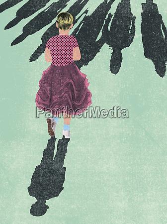 young boy wearing girls dress standing