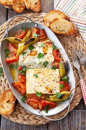 gratinated feta cheese with tomatoes