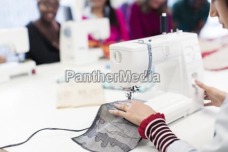 female fashion designer working at sewing