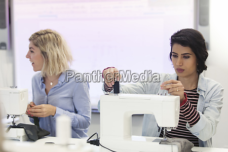 focused female fashion designer working at