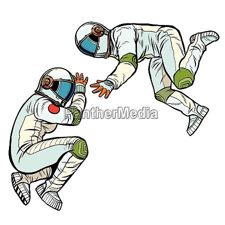 zwei, astronauten, in, der, schwerelosigkeit - 26825554