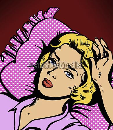 beautiful woman lying awake in bed