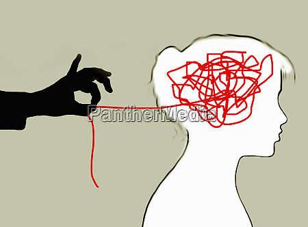 hand unravelling tangled string inside of