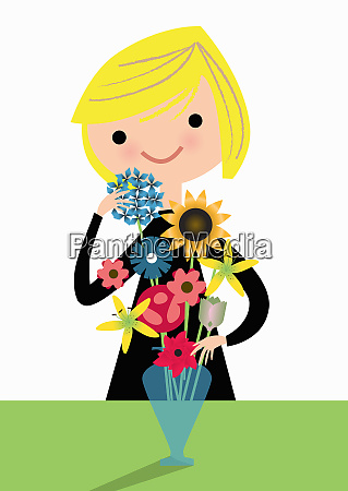 woman arranging flowers in vase