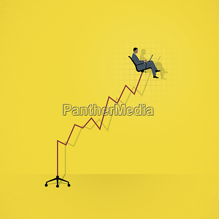 successful businessman sitting high up on