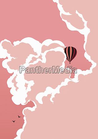 heissluftballon im rosa himmel schwebend