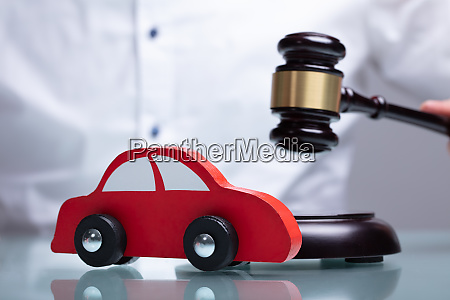 car in front of judge holding
