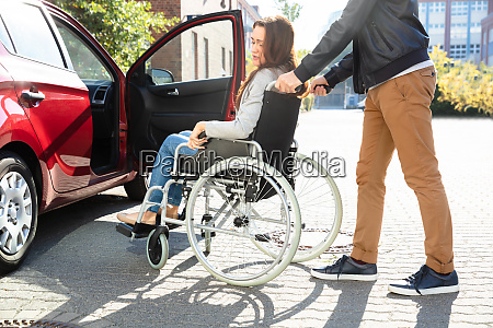 man with her disabled wife moving