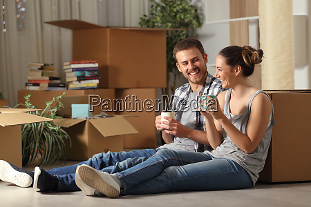 happy couple moving home resting and