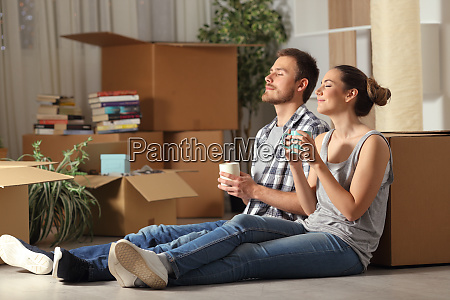 happy couple moving home resting breathing