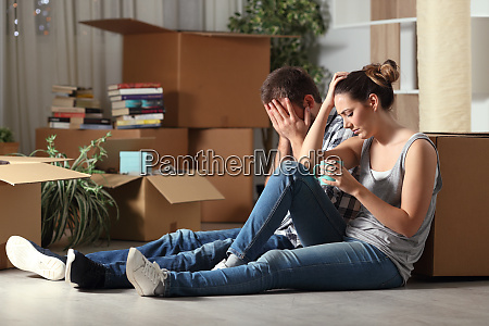 sad evicted couple moving home complaining
