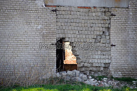 old soviet brick abandoned building collapsing