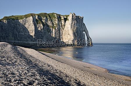 pebble beach and cliff of etretat