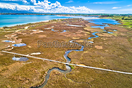 sea marshes and shallow sand beach