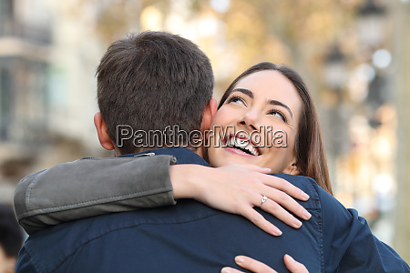 happy girl hugs her boyfriend in
