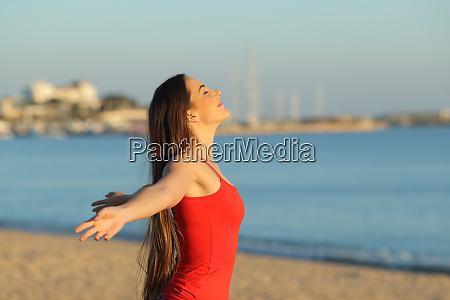 happy girl in red breathing fresh