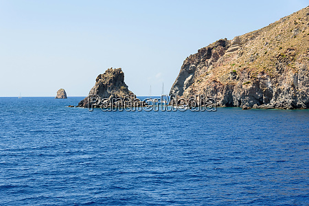 yachts at the rocky coast of