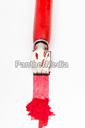 dip pen draws red line with