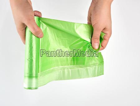 weibliche hand entspannen gruene rolle mit