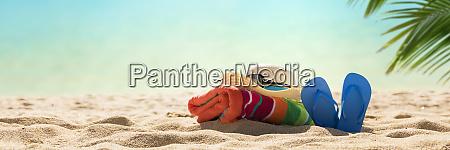 strandzubehoer strohhut flip flops handtuch am