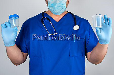 doctor in blue uniform and latex