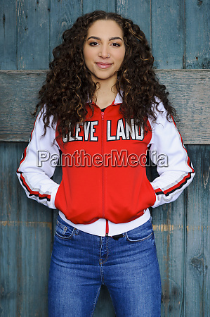mixed race woman wearing cleveland jacket