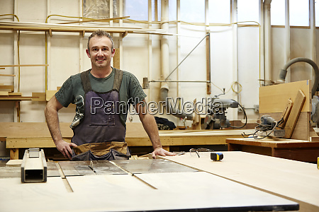 carpenter smiling in workshop