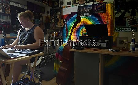 caucasian man playing keyboard in music