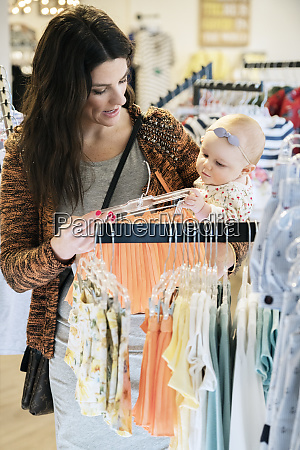 caucasian mother and baby daughter shopping