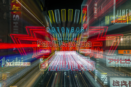 blurred view of neon signs at