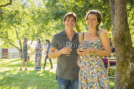 portrait of smiling caucasian couple drinking