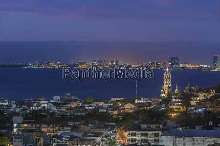 aerial view of illuminated cityscape and
