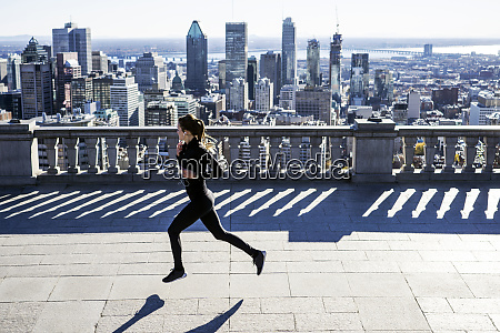 caucasian woman running in city