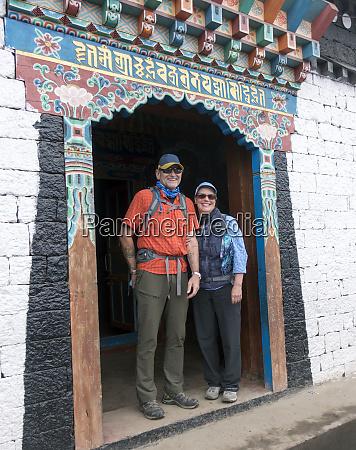 caucasian couple standing in ornate doorway