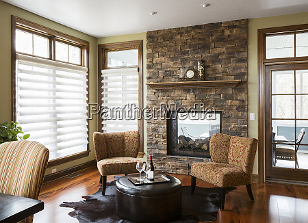 chairs and fireplace in living room