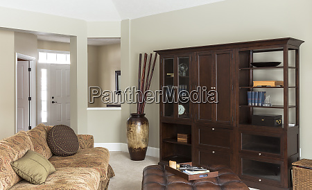 sofa ottoman and cabinets in modern