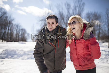 caucasian couple hugging in winter
