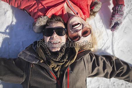 caucasian couple in sunglasses smiling in