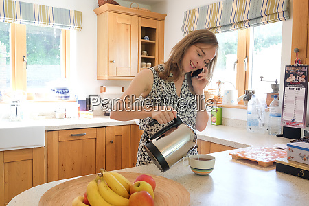 caucasian woman poring coffee and talking