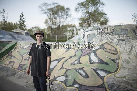 caucasian man standing at skate park