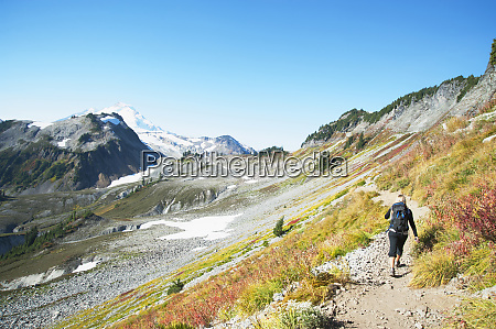 woman hiking on rocky trail on